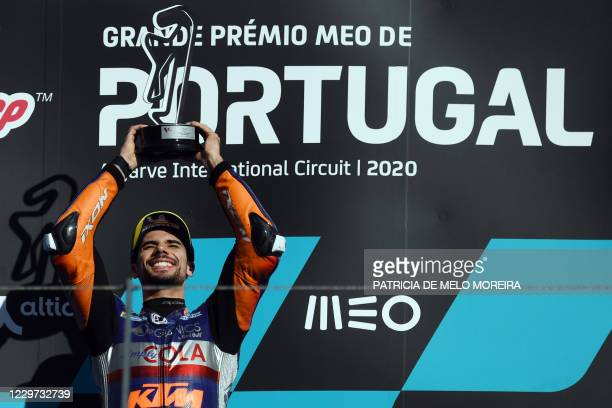 Red Bull KTM Tech 3's Portuguese rider Miguel Oliveira celebrates on the podium after winning the MotoGP race of the Portuguese Grand Prix at the...