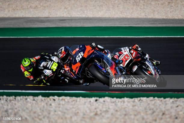 Red Bull KTM Tech 3's Portuguese rider Miguel Oliveira , LCR Honda IDEMITSU's British rider Cal Crutchlow and LCR Honda IDEMITSU's Japanese rider...