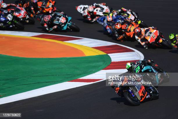 Red Bull KTM Tech 3's Portuguese rider Miguel Oliveira leads at the start of the MotoGP race of the Portuguese Grand Prix at the Algarve...