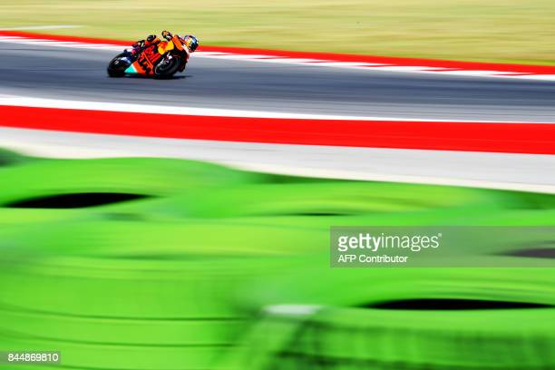 Red Bull KTM's British rider Bradley Smith rides his bike during a practice session for the San Marino Moto GP Grand Prix race at the Marco...