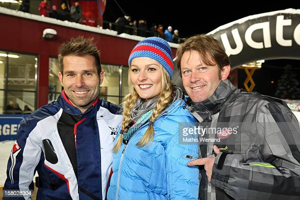 Red Bull pilot Hannes Arch stunt model Miriam Hoeller and Andy Wernig attend the Snow Mobile Race 2012 on December 8 2012 in SaalbachHinterglemm...
