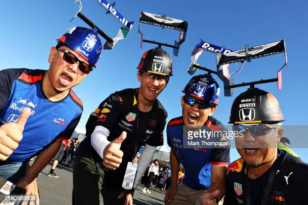 Red Bull Racing and Scuderia Toro Rosso fans show their support before qualifying for the F1 Grand Prix of Japan at Suzuka Circuit on October 13,...