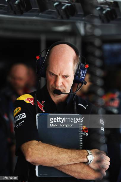 Red Bull Racing Chief Technical Officer Adrian Newey looks on in their team garage during qualifying for the Bahrain Formula One Grand Prix at the...