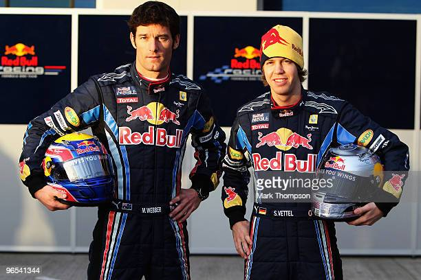 Red Bull Racing drivers Mark Webber of Australia and Sebastian Vettel of Germany unveil the new RB6 during winter testing at the at the Circuito De...