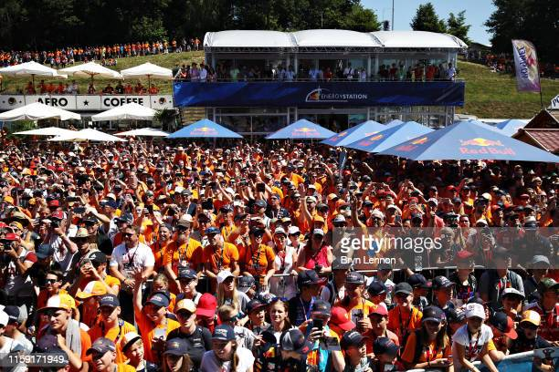 Red Bull Racing fans wait for the drivers to arrive on the fan stage before the F1 Grand Prix of Austria at Red Bull Ring on June 30, 2019 in...