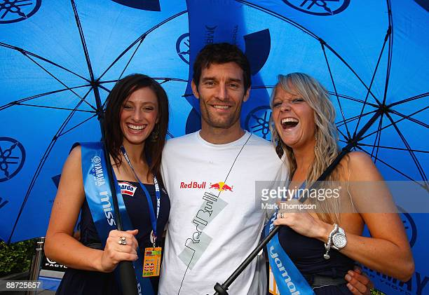 Red Bull racing Formula 1 driver Mark Webber of Australia with Yamaha grid girls at the Castle Donnington race track on June 28 2009 in Donnington...