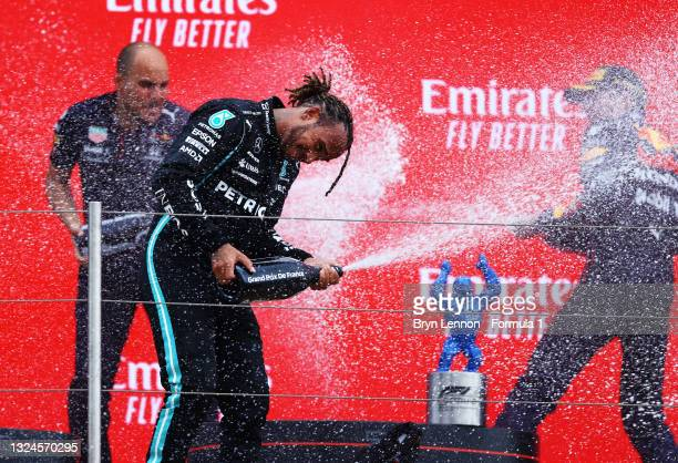 Red Bull Racing race engineer Gianpiero Lambiase, race winner Max Verstappen of Netherlands and Red Bull Racing and second placed Lewis Hamilton of...