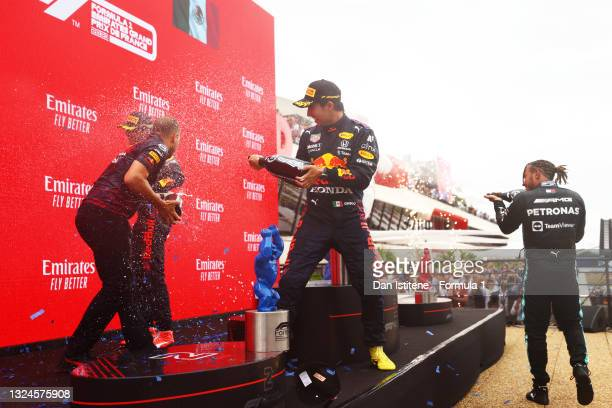 Red Bull Racing race engineer Gianpiero Lambiase, race winner Max Verstappen of Netherlands and Red Bull Racing, third placed Sergio Perez of Mexico...