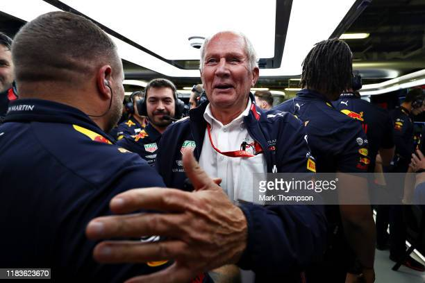 Red Bull Racing Team Consultant Dr Helmut Marko celebrates the pole position of Max Verstappen of Netherlands and Red Bull Racing in the garage...