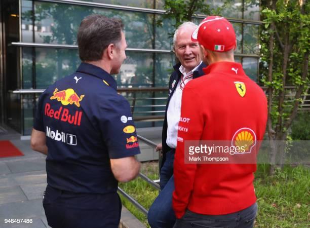 Red Bull Racing Team Consultant Dr Helmut Marko Red Bull Racing Team Principal Christian Horner and Sebastian Vettel of Germany and Ferrari talk...
