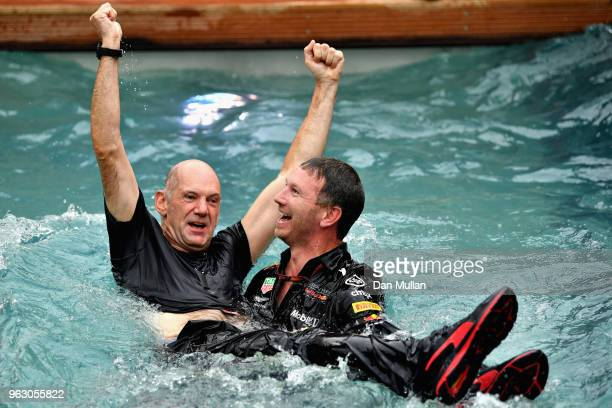 Red Bull Racing Team Principal Christian Horner and Adrian Newey the Chief Technical Officer of Red Bull Racing celebrate the race win of Daniel...