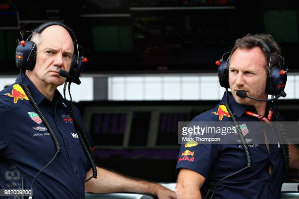 Red Bull Racing Team Principal Christian Horner and Adrian Newey the Chief Technical Officer of Red Bull Racing look on from the pit wall during...