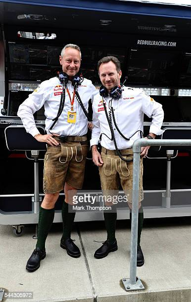 Red Bull Racing Team Principal Christian Horner and Red Bull Racing Team Manager Jonathan Wheatley wear lederhosen on the pitwall during the Formula...