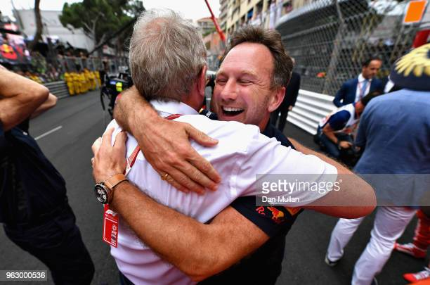 Red Bull Racing Team Principal Christian Horner and Red Bull Racing Team Consultant Dr Helmut Marko celebrate the win of Daniel Ricciardo of...