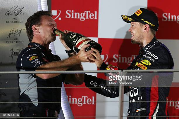 Red Bull Racing Team Principal Christian Horner and Sebastian Vettel of Germany and Infiniti Red Bull Racing celebrate their team's victory following...