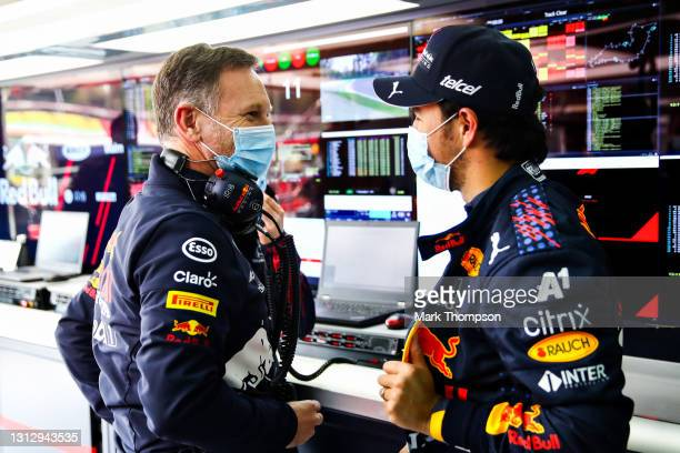 Red Bull Racing Team Principal Christian Horner and Sergio Perez of Mexico and Red Bull Racing talk in the garage during final practice ahead of the...