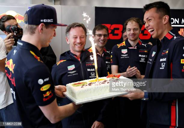 Red Bull Racing Team Principal Christian Horner is presented with a birthday cake by Max Verstappen of Netherlands and Red Bull Racing and Alexander...