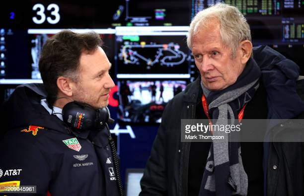 Red Bull Racing Team Principal Christian Horner speaks with Red Bull Racing Team Consultant Dr Helmut Marko in the garage during Day Two of F1 Winter...
