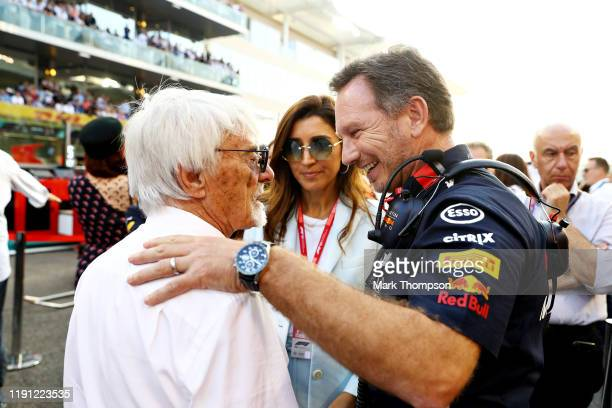 Red Bull Racing Team Principal Christian Horner talks with Bernie Ecclestone Chairman Emeritus of the Formula One Group on the grid before the F1...