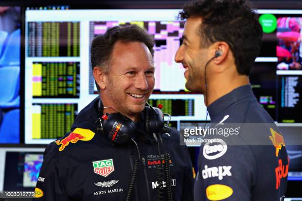 Red Bull Racing Team Principal Christian Horner talks with Daniel Ricciardo of Australia and Red Bull Racing in the garage during final practice for...