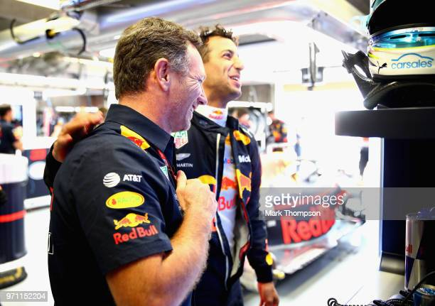 Red Bull Racing Team Principal Christian Horner talks with Daniel Ricciardo of Australia and Red Bull Racing in the garage before the Canadian...