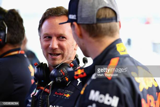 Red Bull Racing Team Principal Christian Horner talks with Max Verstappen of Netherlands and Red Bull Racing in the garage during practice for the...