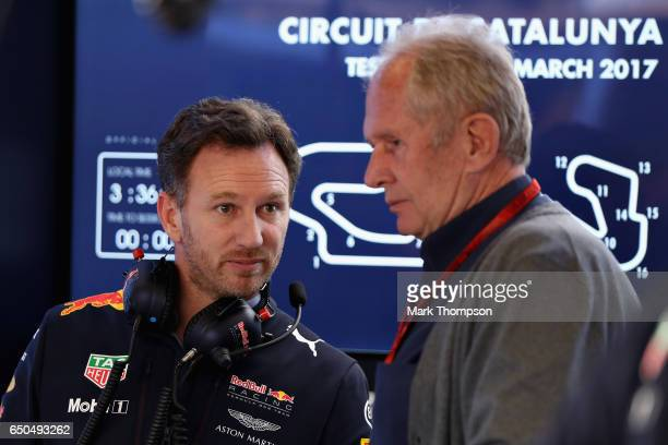 Red Bull Racing Team Principal Christian Horner talks with Red Bull Racing Team Consultant Dr Helmut Marko in the garage during day three of Formula...