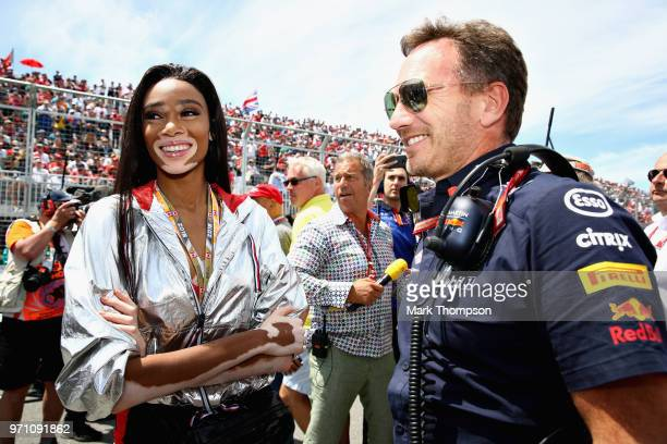 Red Bull Racing Team Principal Christian Horner talks with supermodel Winnie Harlow on the grid before the Canadian Formula One Grand Prix at Circuit...