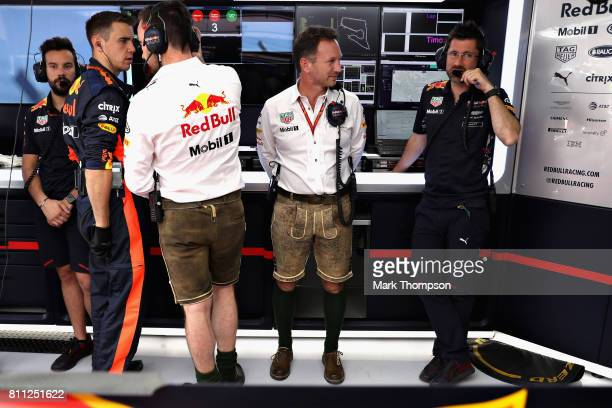 Red Bull Racing Team Principal Christian Horner wears lederhosen in the garage before the Formula One Grand Prix of Austria at Red Bull Ring on July...
