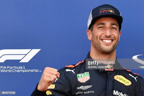 TOPSHOT Red Bull Racing's Australian driver Daniel Ricciardo celebrates winning the pole position after the qualifying session at the Monaco street...