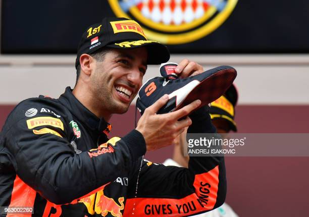 Red Bull Racing's Australian driver Daniel Ricciardo drinks champagne from his shoe on the podium after winning the Monaco Formula 1 Grand Prix at...