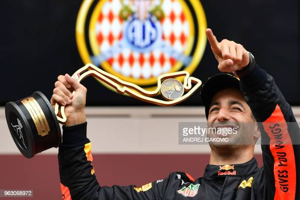 TOPSHOT Red Bull Racing's Australian driver Daniel Ricciardo holds the trophy as he celebrates winning the Monaco Formula 1 Grand Prix at the Monaco...