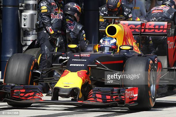Red Bull Racing's Australian driver Daniel Ricciardo leaves the pit lane after changing his tyres during the Formula One Malaysian Grand Prix in...
