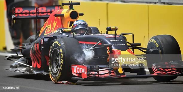 TOPSHOT Red Bull Racing's Australian driver Daniel Ricciardo sits in his damaged car following a crash at the Baku City Circuit on June 17 2016 in...