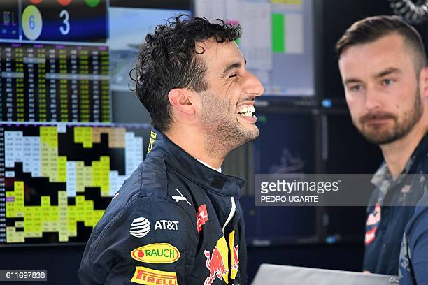 Red Bull Racing's Australian driver Daniel Ricciardo smiles after finishing the third practice session of the Formula One Malaysian Grand Prix in...