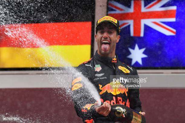TOPSHOT Red Bull Racing's Australian driver Daniel Ricciardo sprays champagne on the podium as he celebrates winning the Monaco Formula 1 Grand Prix...