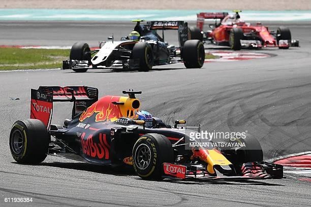 TOPSHOT Red Bull Racing's Australian driver Daniel Ricciardo takes a corner during the Formula One Malaysian Grand Prix in Sepang on October 2 2016 /...