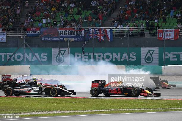Red Bull Racing's Belgian-Dutch driver Max Verstappen and Red Bull Racing's Australian driver Daniel Ricciardo pass Mercedes AMG Petronas F1 Team's...