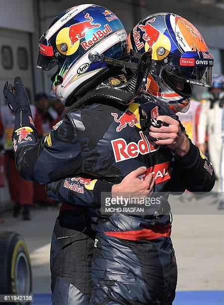 Red Bull Racing's BelgianDutch driver Max Verstappen congratulates his teammate Daniel Ricciardo after he won the Formula One Malaysian Grand Prix in...