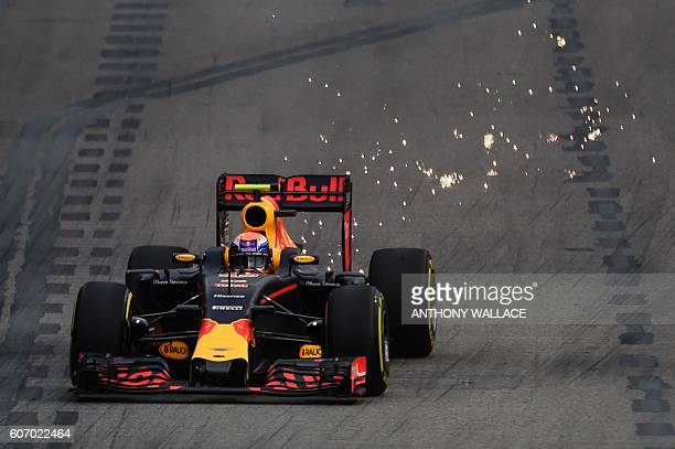 TOPSHOT Red Bull Racing's BelgianDutch driver Max Verstappen takes a corner during the third practice session on September 17 ahead of the Formula...