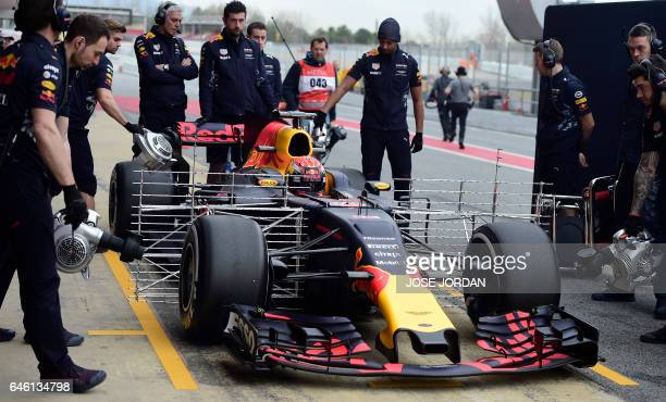 Red Bull Racing's Dutch driver Max Verstappen arrives in the pitlane at the Circuit de Catalunya on February 28 2017 in Montmelo on the outskirts of...