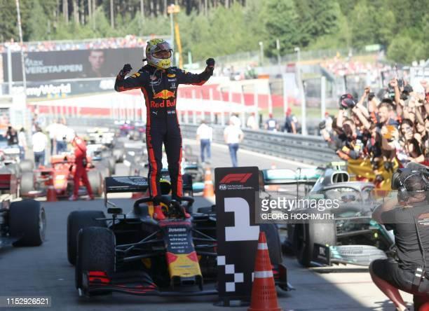 TOPSHOT Red Bull Racing's Dutch driver Max Verstappen celebrates winning the Austrian Formula One Grand Prix in Spielberg on June 30 2019 Max...