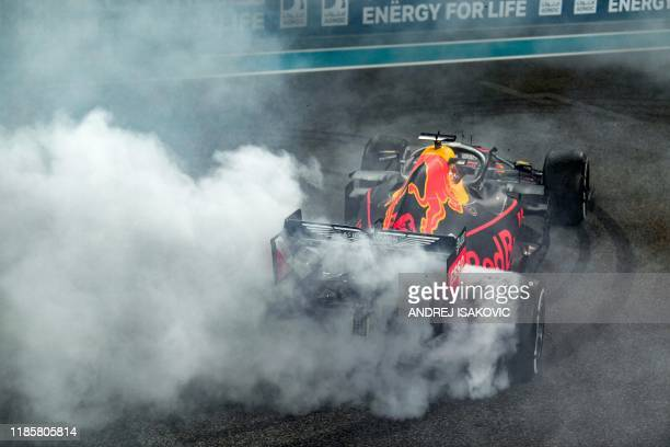 Red Bull Racing's Dutch driver Max Verstappen performs doughnuts as he celebrates his second place finish at the Yas Marina Circuit in Abu Dhabi,...