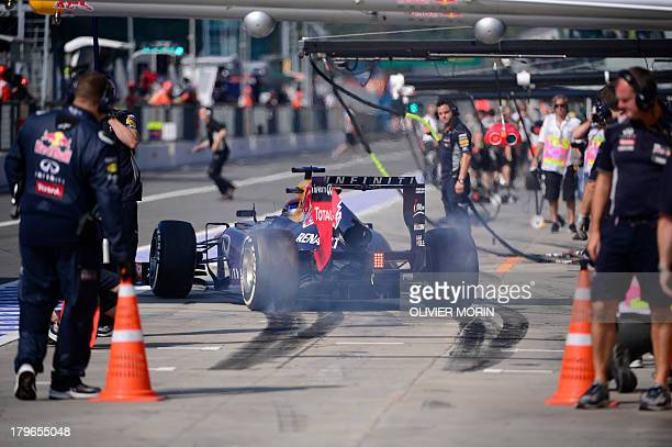 Red Bull Racing's German driver Sebastian Vettel leaves the pits during the second practice session at the Autodromo Nazionale circuit in Monza on...