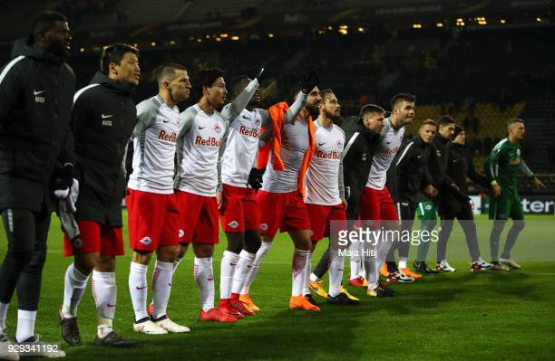 Red Bull Salzburg players celebrate victory after the UEFA Europa League Round of 16 match between Borussia Dortmund and FC Red Bull Salzburg at the...