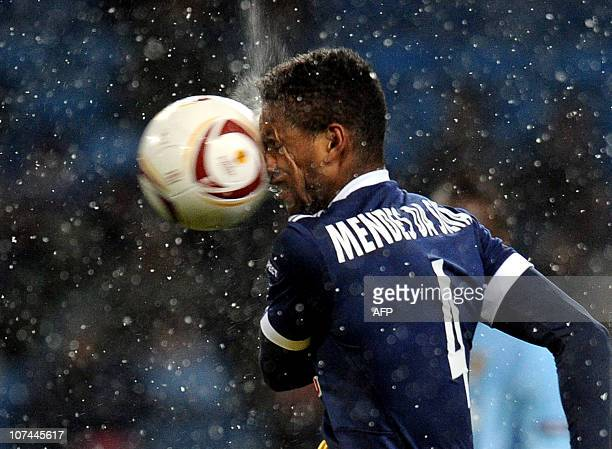 Red Bull Salzburg's Dutch midfielder David Mendes da Silva is hit in the face with the ball during the UEFA Europa League group A football match...