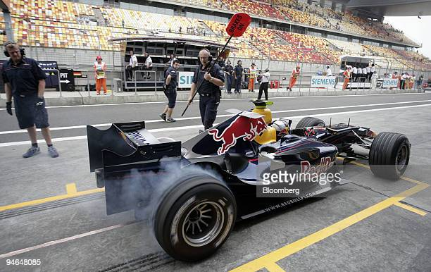 Red Bull Testdriver Michael Ammermueller from Germany drives from the pits during the first practise day of the Formula 1 Grand Prix of China in...