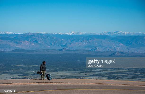 Red Bull'c cinematographer Milan scouts for a filming position in the top part of the mountain for the June 30 Pikes Peak International Hill Climb at...