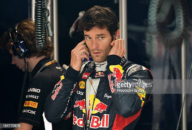 Red Bull-Renault driver Mark Webber of Australia gestures as he gets ready during the first practice session at The Buddh International circuit in...
