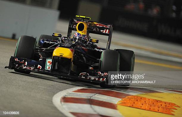 Red Bull-Renault driver Mark Webber of Australia powers his car during the third practice session of the Formula One's Singapore Grand Prix night...